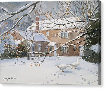 Farmhouse In The Snow Canvas Print by Lucy Willis