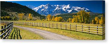 Fence Along A Road, Sneffels Range Canvas Print by Panoramic Images