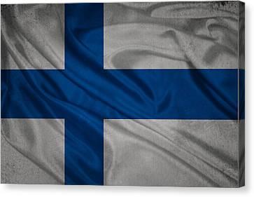 Finnish Flag Waving On Canvas Canvas Print by Eti Reid