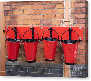 Fire Buckets At Toddington Railway Station Canvas Print by Louise Heusinkveld