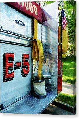 Fireman - Hose In Bucket On Fire Truck Canvas Print by Susan Savad