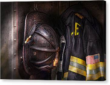 Fireman - Worn And Used Canvas Print by Mike Savad