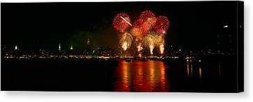 Fireworks Display At Night Canvas Print by Panoramic Images