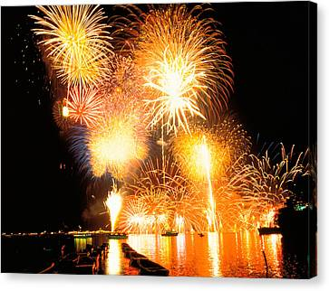 Fireworks Display In Night Canvas Print by Panoramic Images