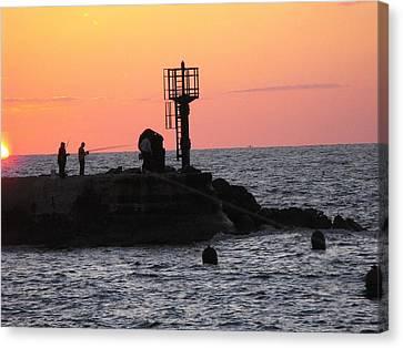 Fishermen At Sunset Canvas Print by Lionel Gaffen