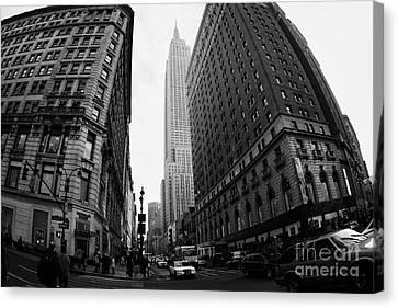 fisheye shot View of the empire state building from West 34th Street and Broadway junction Canvas Print by Joe Fox