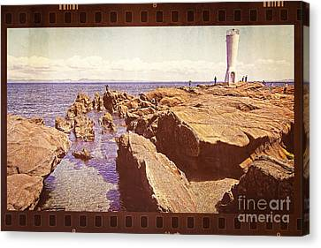 Fishing At Noon By The Lighthouse Canvas Print by Beverly Claire Kaiya