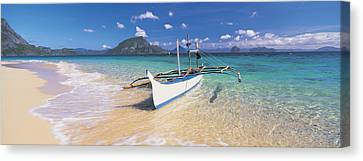 Fishing Boat Moored On The Beach Canvas Print by Panoramic Images