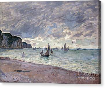 Fishing Boats In Front Of The Beach And Cliffs Of Pourville Canvas Print by Claude Monet