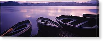 Fishing Boats Moored In A Lake, Loch Canvas Print by Panoramic Images