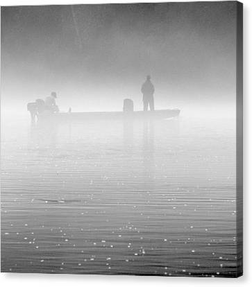 Fishing In The Fog Canvas Print by Mike McGlothlen