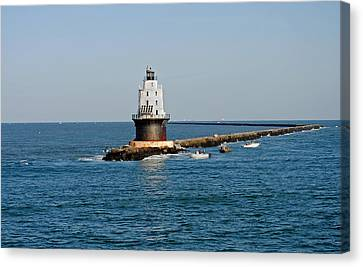 Fishing The Breakwater Canvas Print by Skip Willits