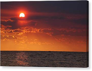 Fishing Till The Sun Goes Down Canvas Print by Michael Thomas