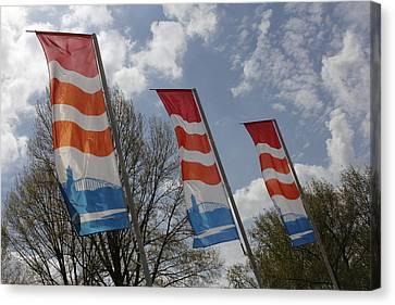 Flags Fluttering In The John Frost Bridge Canvas Print by Ronald Jansen