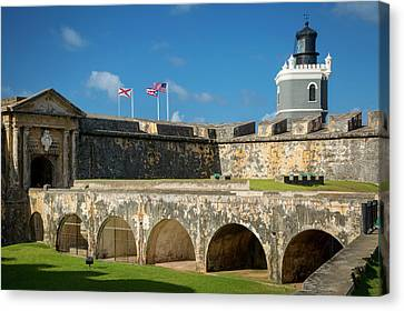 Flags Flying Over Fortress El Morro Canvas Print by Brian Jannsen