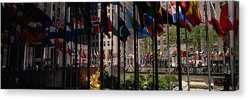Flags In A Row, Rockefeller Plaza Canvas Print by Panoramic Images