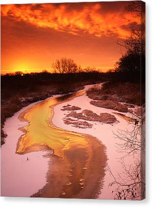 Flaming Sunrise Canvas Print by Ray Mathis