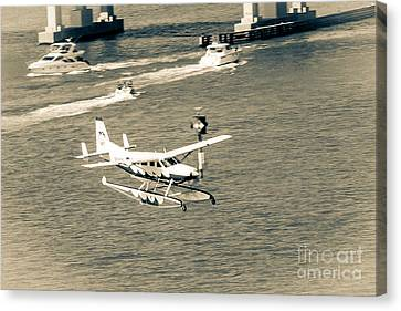 Flight- Landing In The Bay Canvas Print by Rene Triay Photography