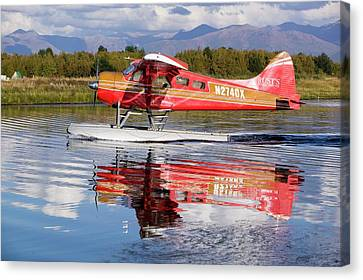 Float Plane Flying Into Anchorage Canvas Print by Ashley Cooper