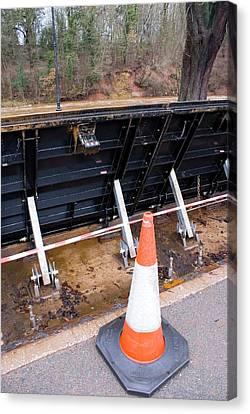 Flood Barrier In Appleby Canvas Print by Mark Williamson