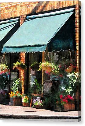 Flower Shop With Green Awnings Canvas Print by Susan Savad