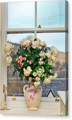 Flowers In The Window Canvas Print by Tom Gowanlock