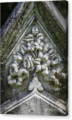 Flowers On A Grave Stone Canvas Print by Edward Fielding