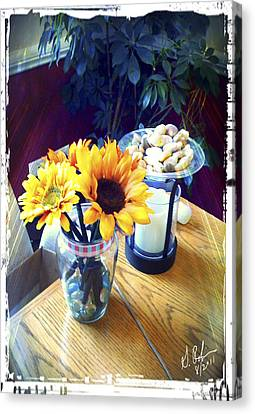 Flowers On Table Canvas Print by Gerry Robins