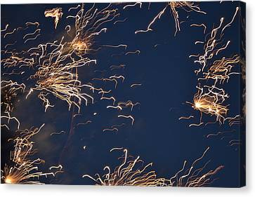 Flying Fireworks Canvas Print by Kim Stafford