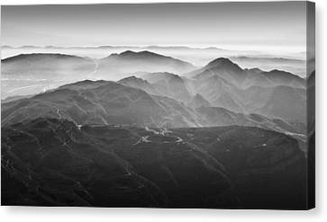 Foggy Mountains Canvas Print by Nadya Ost