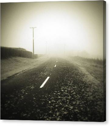 Foggy Road  Canvas Print by Les Cunliffe