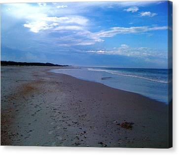 Footprints In The Sand Canvas Print by Julie Wilcox