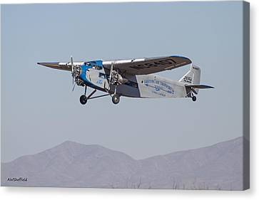 Ford Tri-motor Taking Off Canvas Print by Allen Sheffield