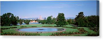 Formal Garden In City Park With City Canvas Print by Panoramic Images