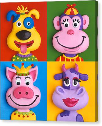 Four Animal Faces Canvas Print by Amy Vangsgard
