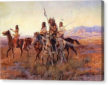 Four Mounted Indians Canvas Print by Charles Russell