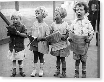Four Young Children Singing Canvas Print by Underwood Archives