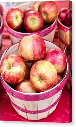 Fresh Apples In Buschel Baskets At Farmers Market Canvas Print by Teri Virbickis