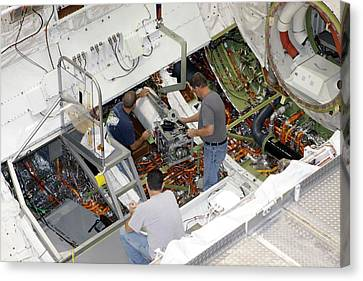 Fuel Cell Removal From Space Shuttle Canvas Print by Glenn Benson/nasa