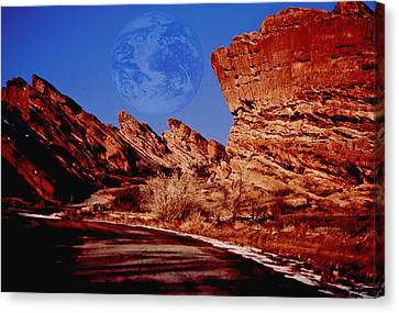 Full Earth Over Red Rocks Canvas Print by Kellice Swaggerty