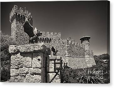 Gargoyles On A Castle Wall Canvas Print by George Oze