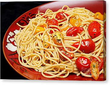 Garlic Pasta And Grape Tomatoes Canvas Print by Andee Design