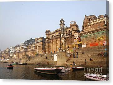 Ghats And Boats On The River Ganges At Varanasi In India Canvas Print by Robert Preston