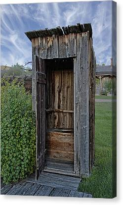Ghost Town Outhouse - Montana Canvas Print by Daniel Hagerman