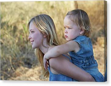 Girl Carrying Sister On Back Canvas Print by Ruth Jenkinson