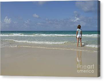 Girl Contemplating Ocean From Beach Canvas Print by Sami Sarkis