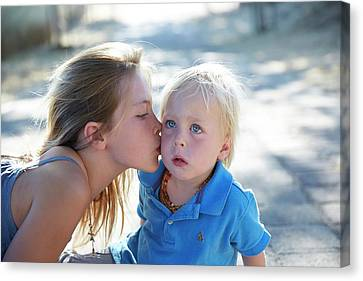 Girl Kissing Brother On Cheek Canvas Print by Ruth Jenkinson