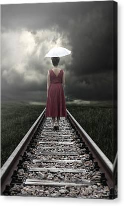 Girl On Tracks Canvas Print by Joana Kruse
