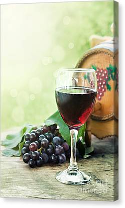 Glass Of Red Wine  Canvas Print by Mythja  Photography