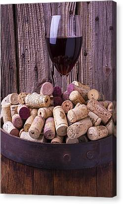 Glass Of Wine With Corks Canvas Print by Garry Gay